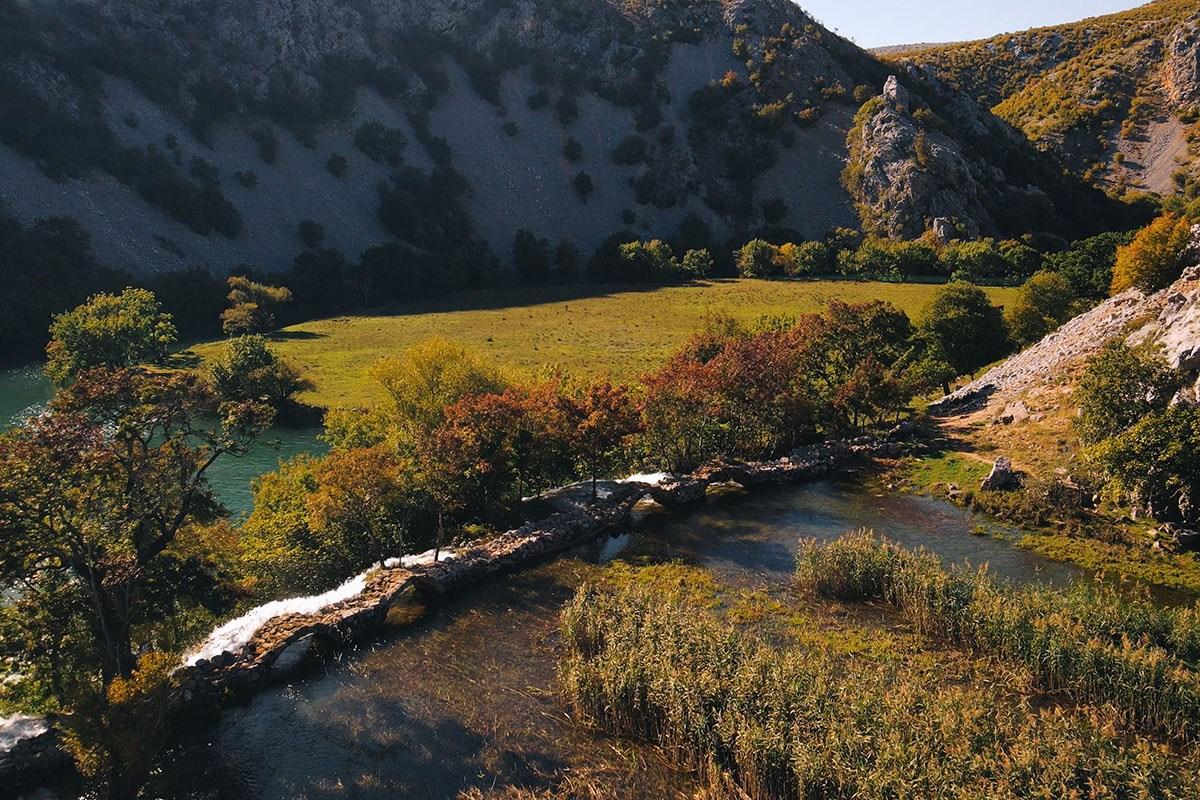 River krupa and kuda's bridge, meadow in croatia