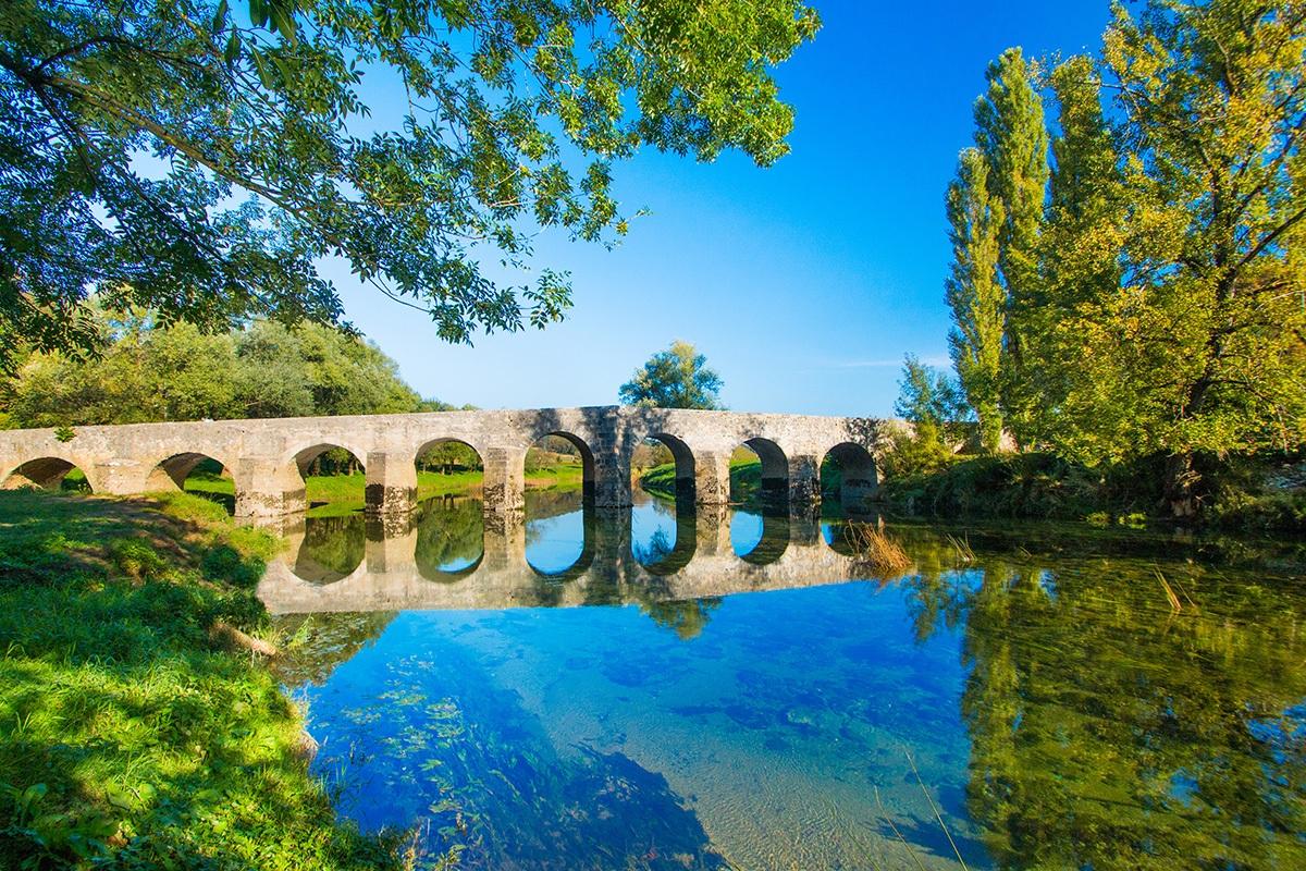 Dobra River. Old stone bridge, Novigrad, Karlovac